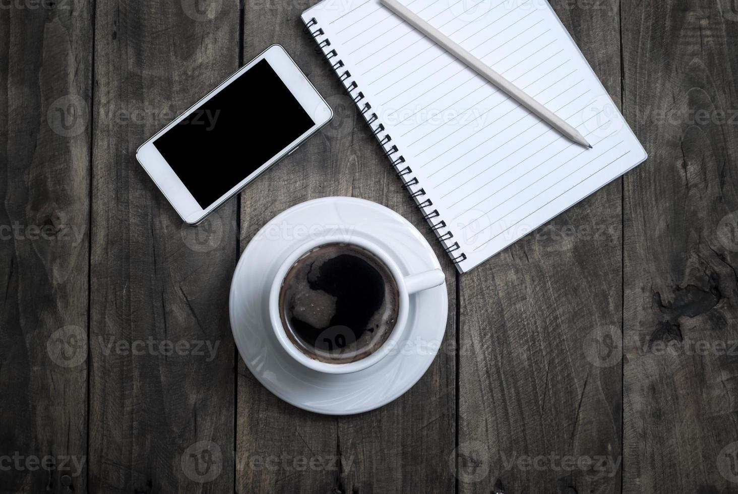Black  blank screen on the phone and cup of coffee photo