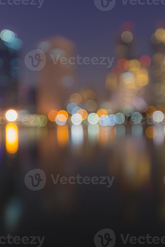 Abstract, night cityscape light blur bokeh, defocused background. photo