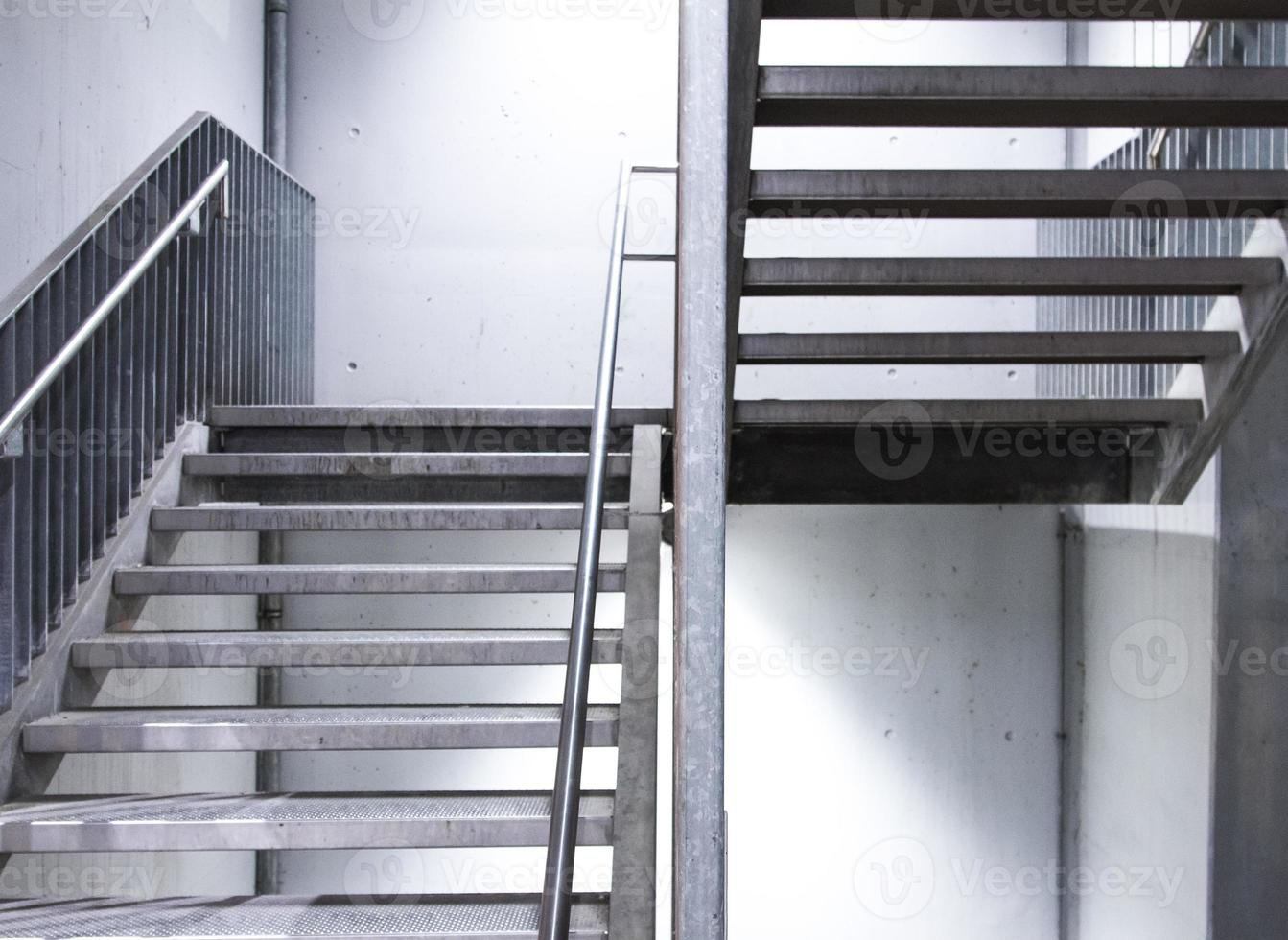 steel staircase with beton wall photo