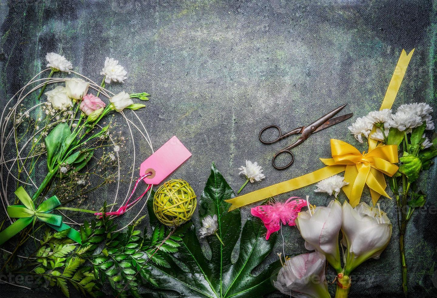 Beautiful flowers, pair of scissors and tools to create bouquet photo
