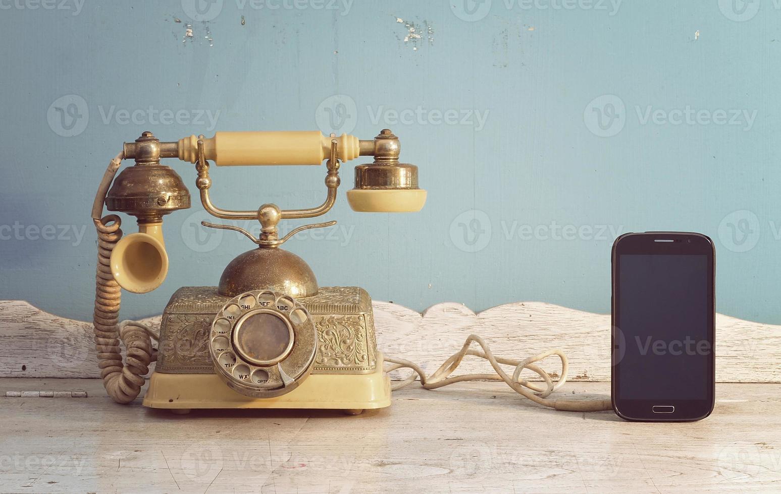 vintage telephone and smartphone. photo