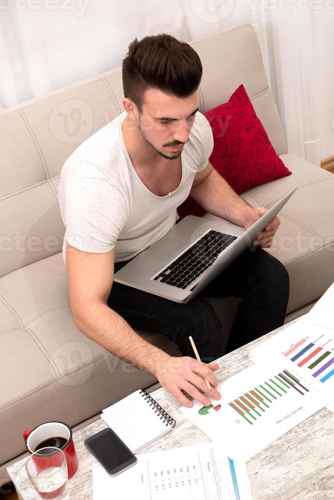 Businessman working at home photo