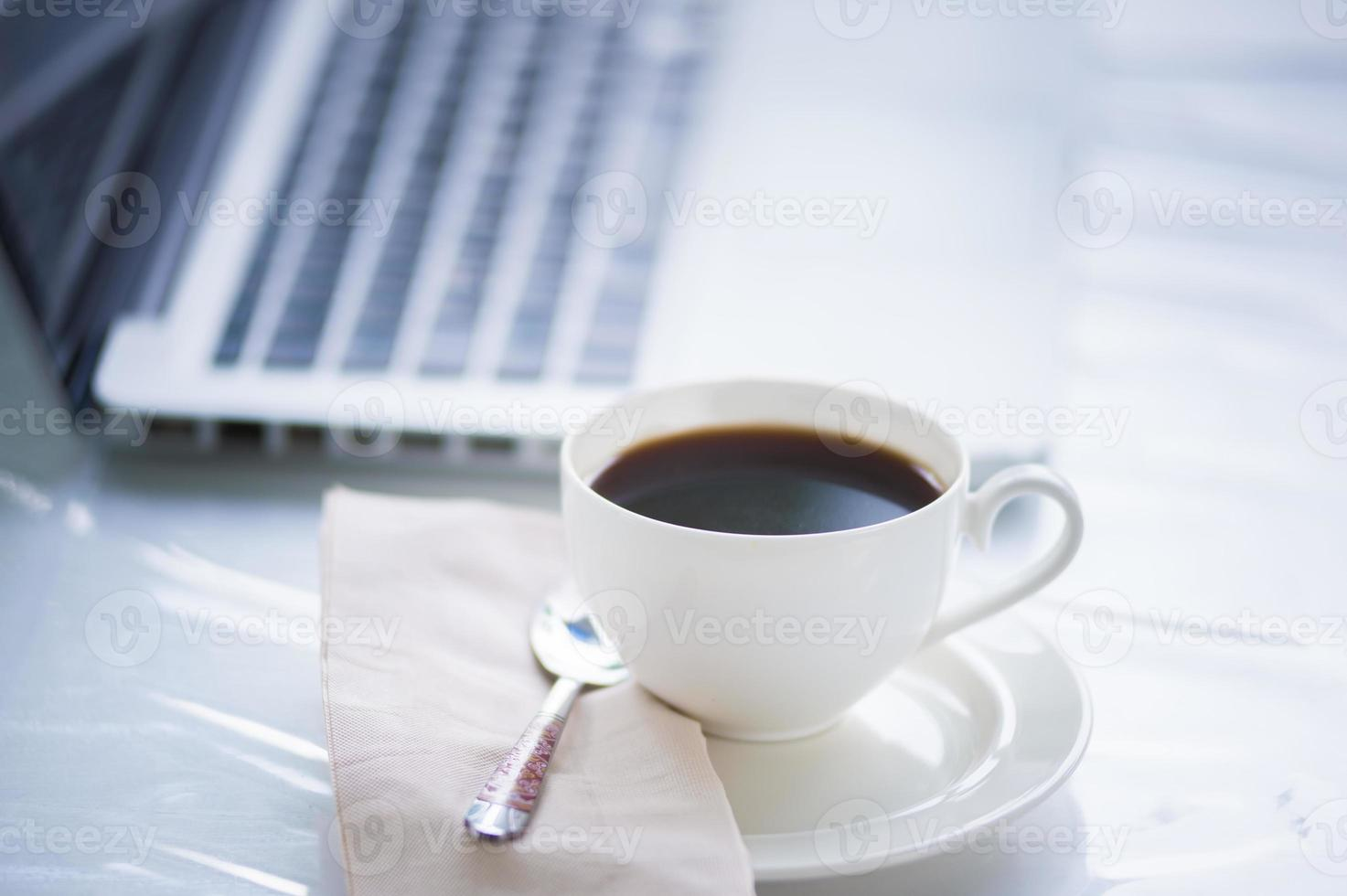 Coffee cup and laptop for business photo