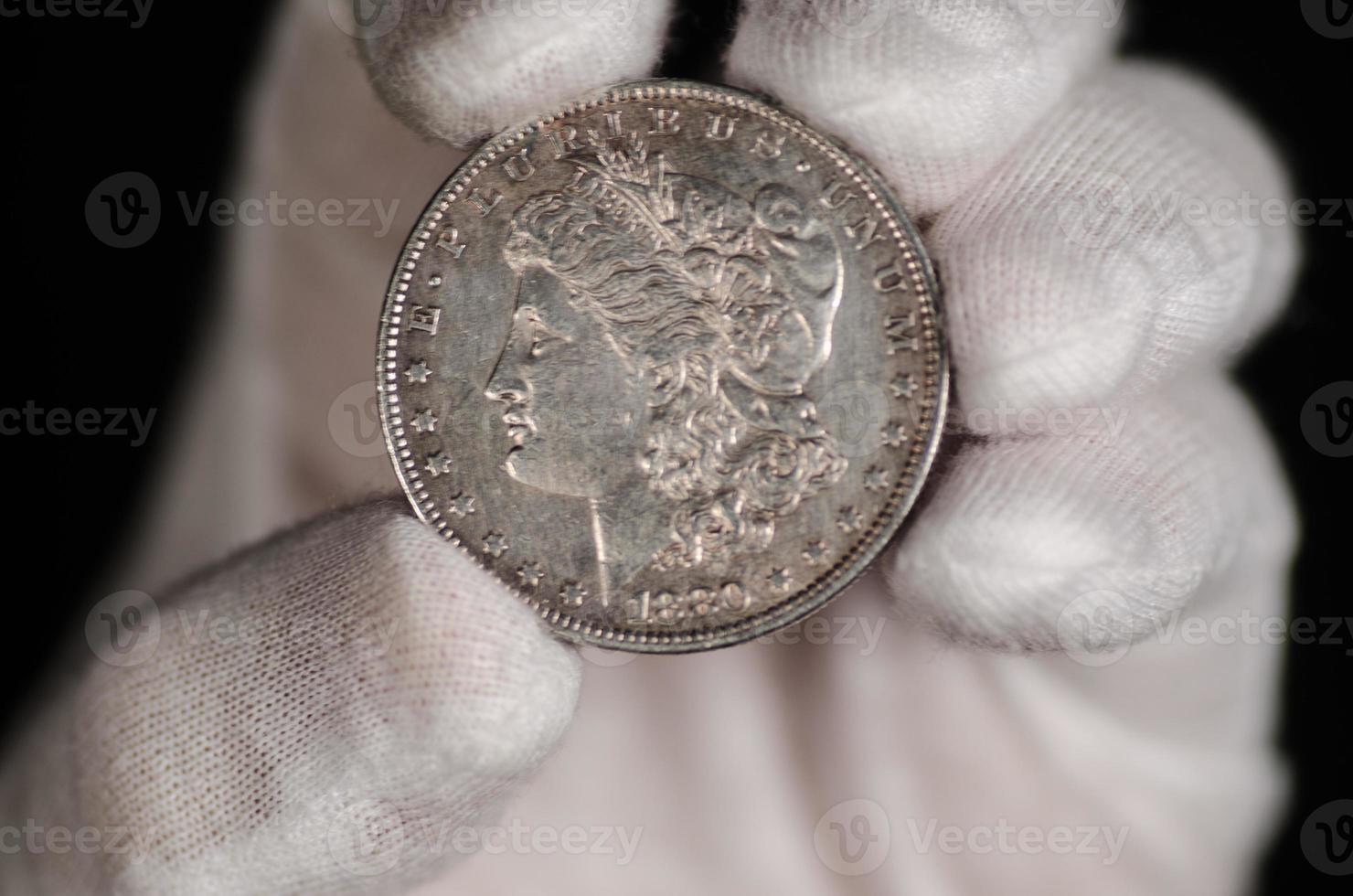 US Morgan Silver Dollar Coin Hand Held photo