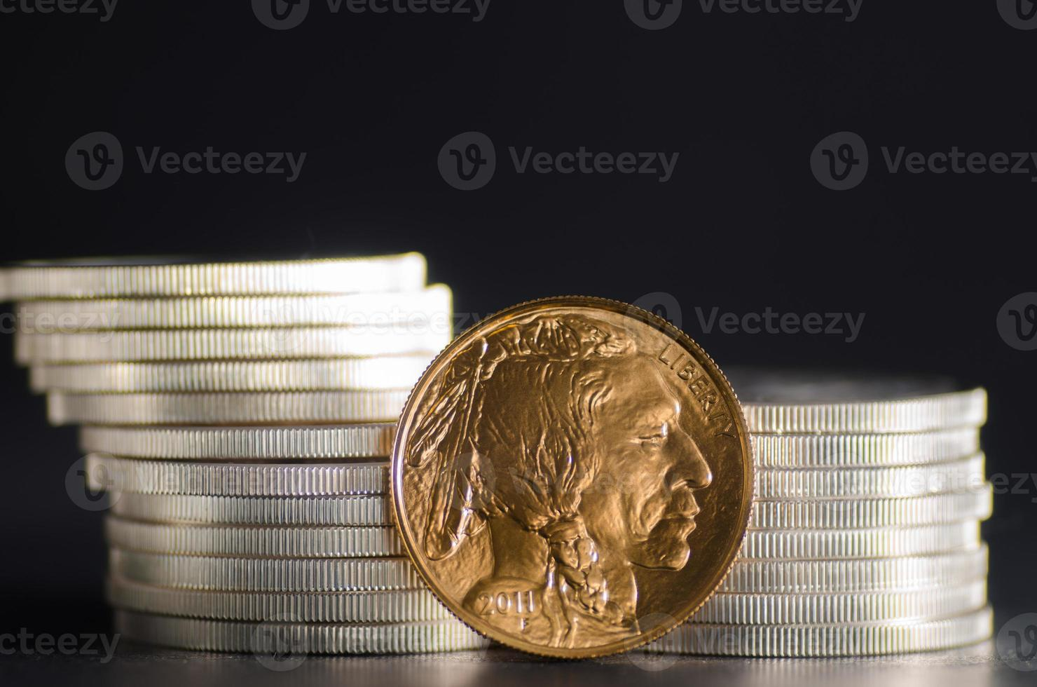 United States Gold Buffalo infront of SIlver Coins photo