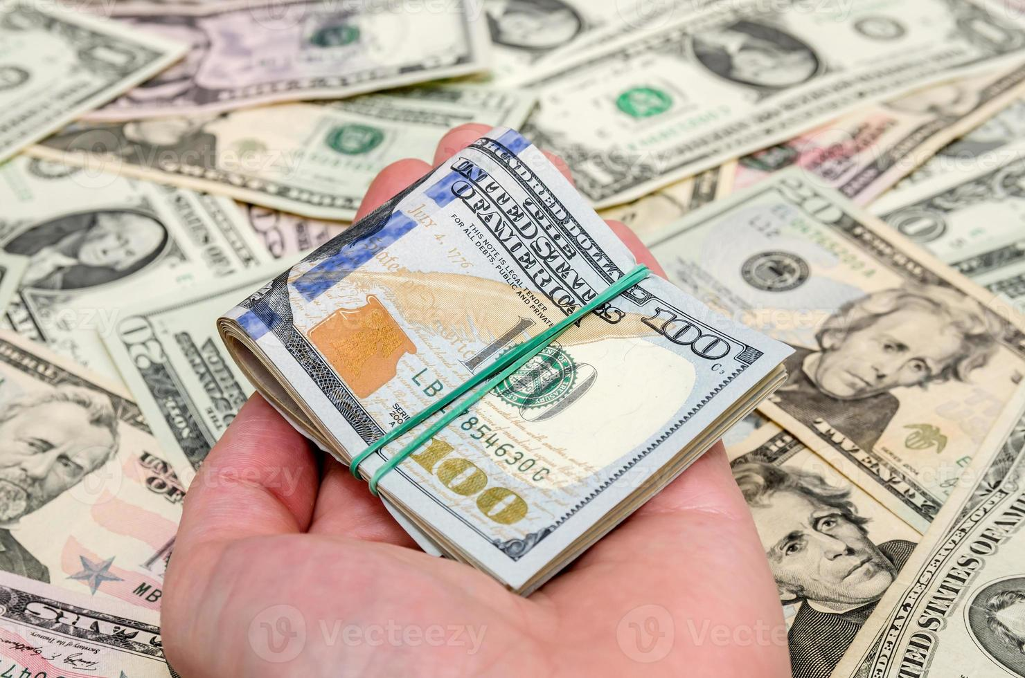 different dollar bills as background photo