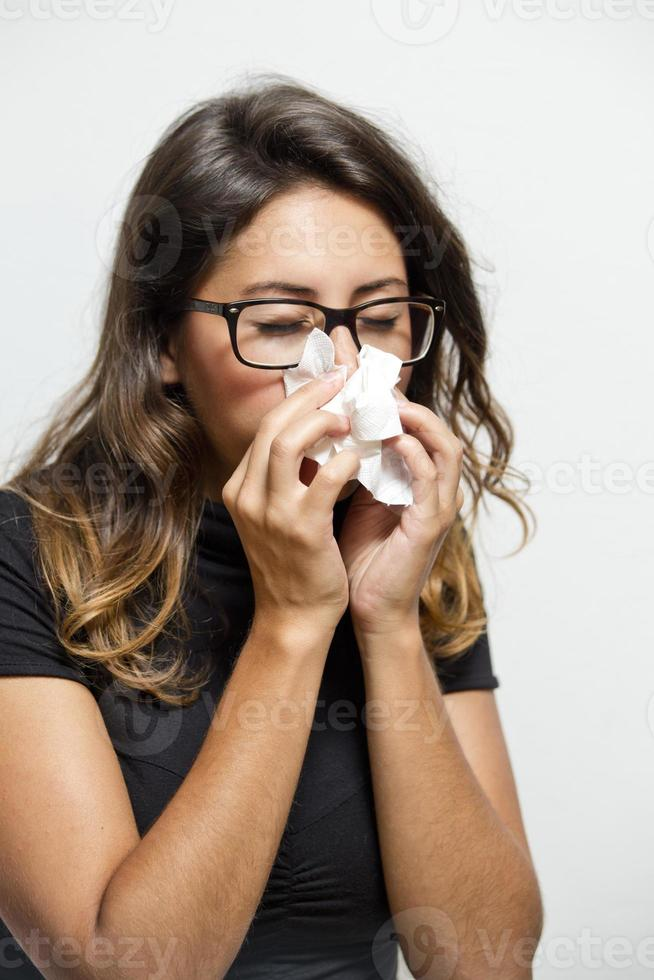 Hipster Girl Blowing Her Nose photo