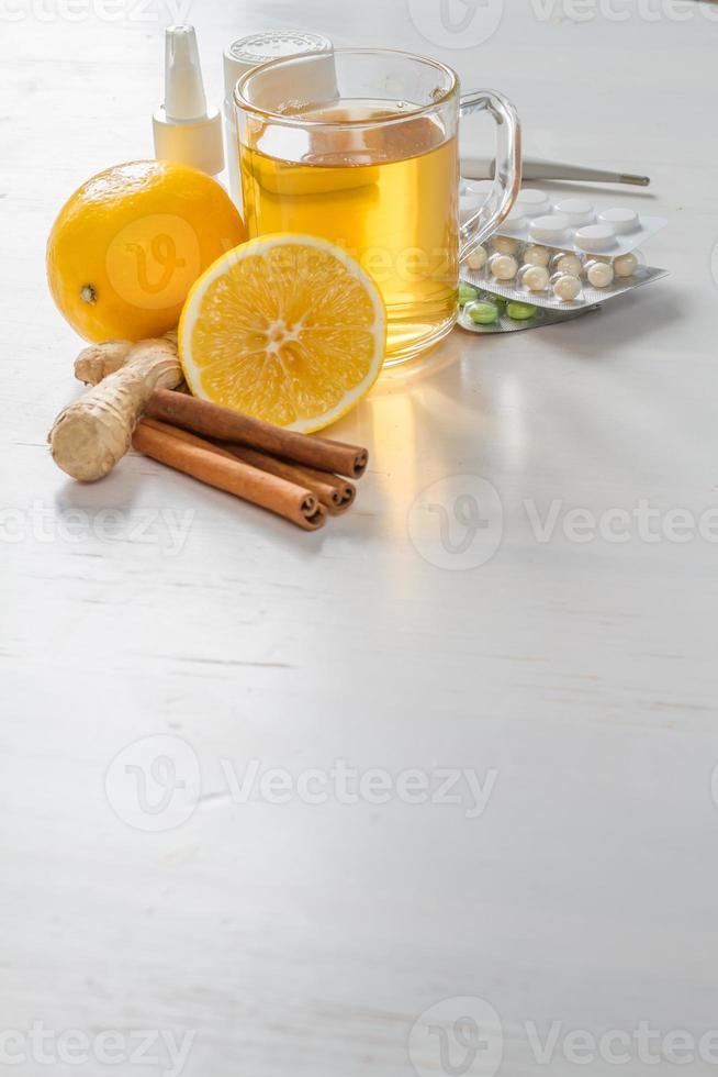 Cold care - tea, lemons, honey, ginger, cinnamon sticks, drugs photo