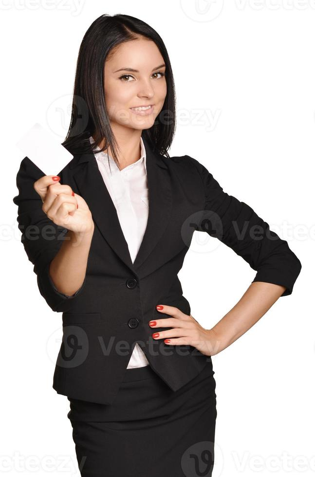 Business woman holding in one hand a blank white business card. photo