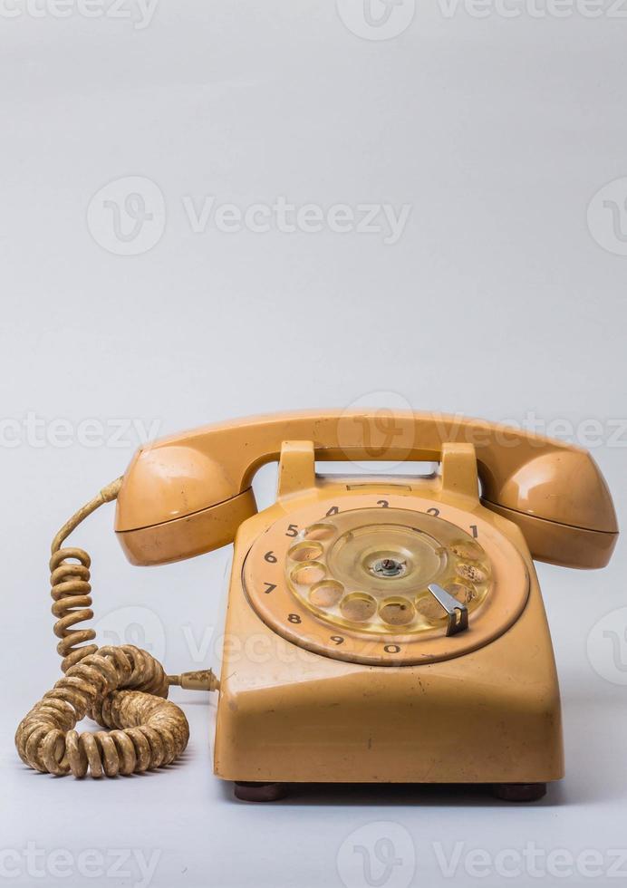 telefone antigo em fundo. foto