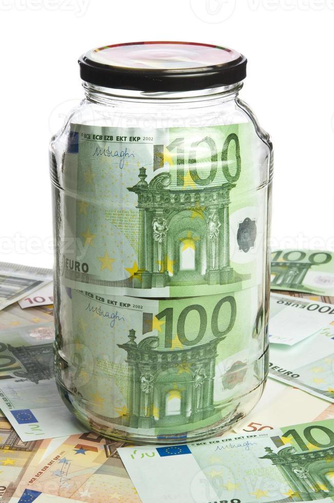 Glass jar and euro banknotes photo