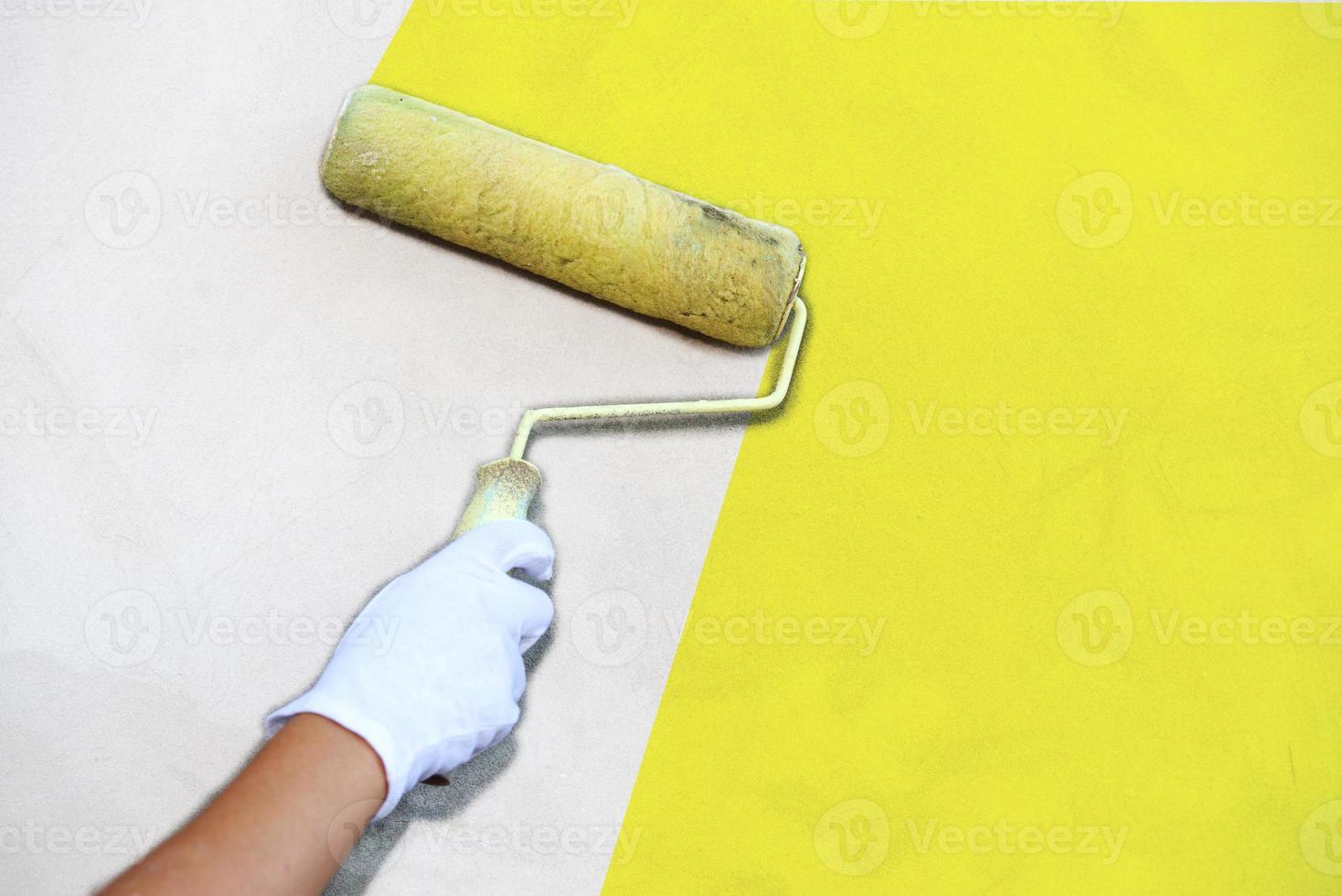 Paintbrush paint the wall photo