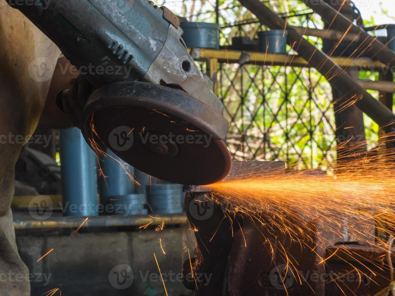 Grinding machine hand spinning with fire line photo