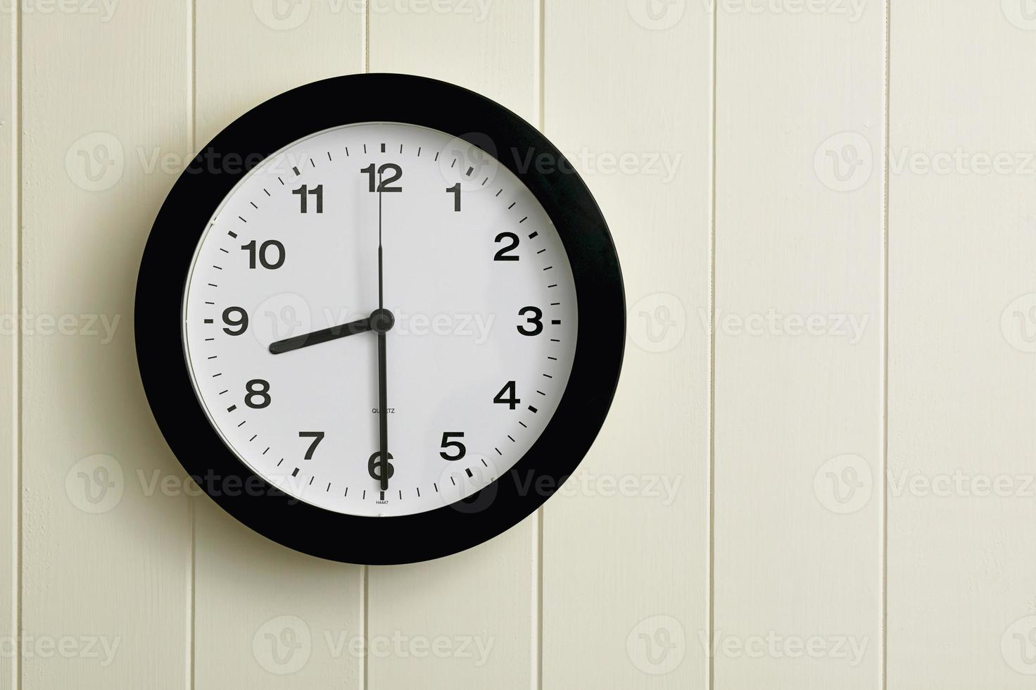 Clock on painted wood panel wall photo