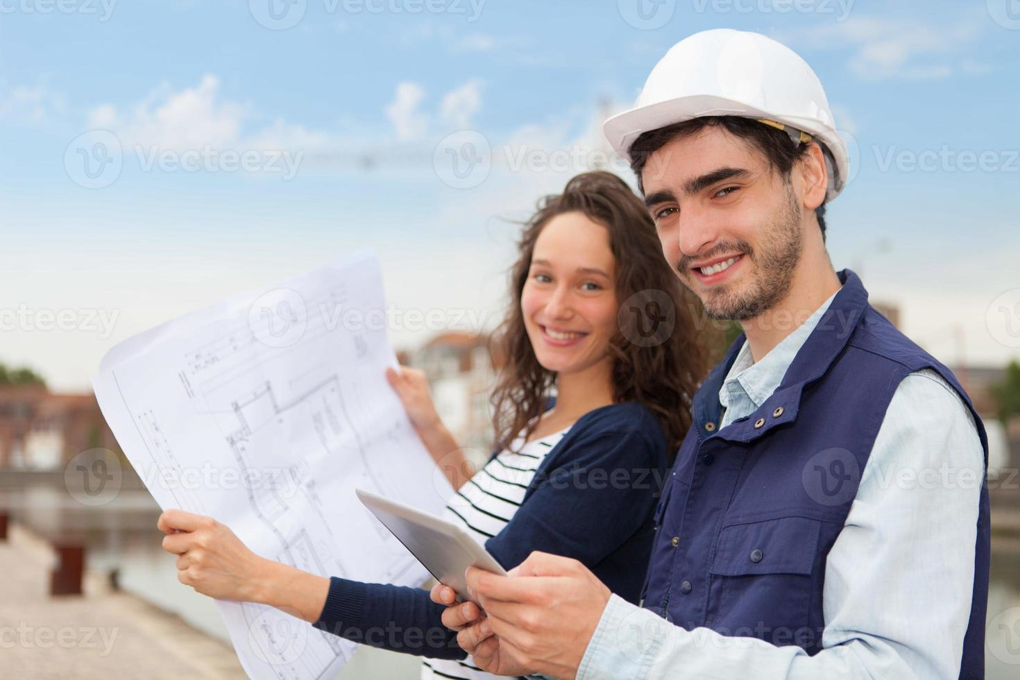 Architect woman and construction site supervisor photo