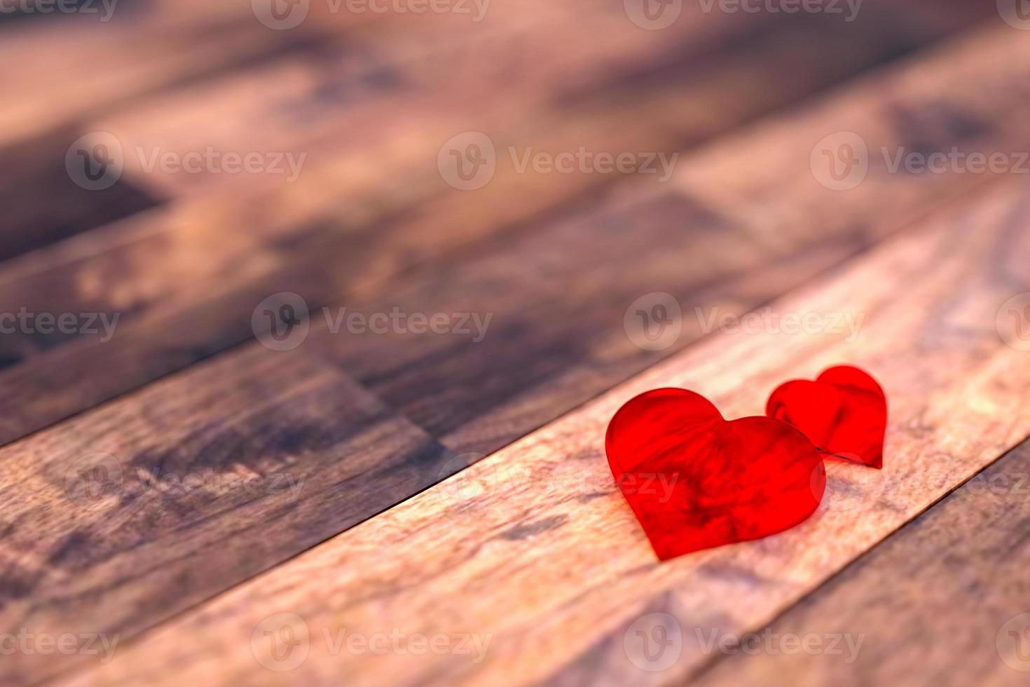 dos corazones en el piso de madera foto