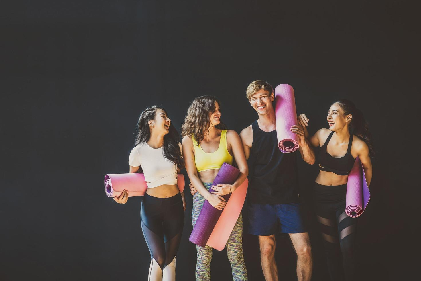 Young active people training together at a yoga class photo