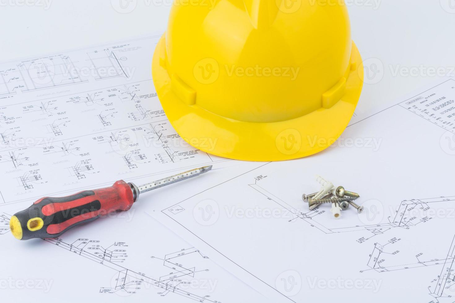 Yellow safety helmet and screwdriver photo