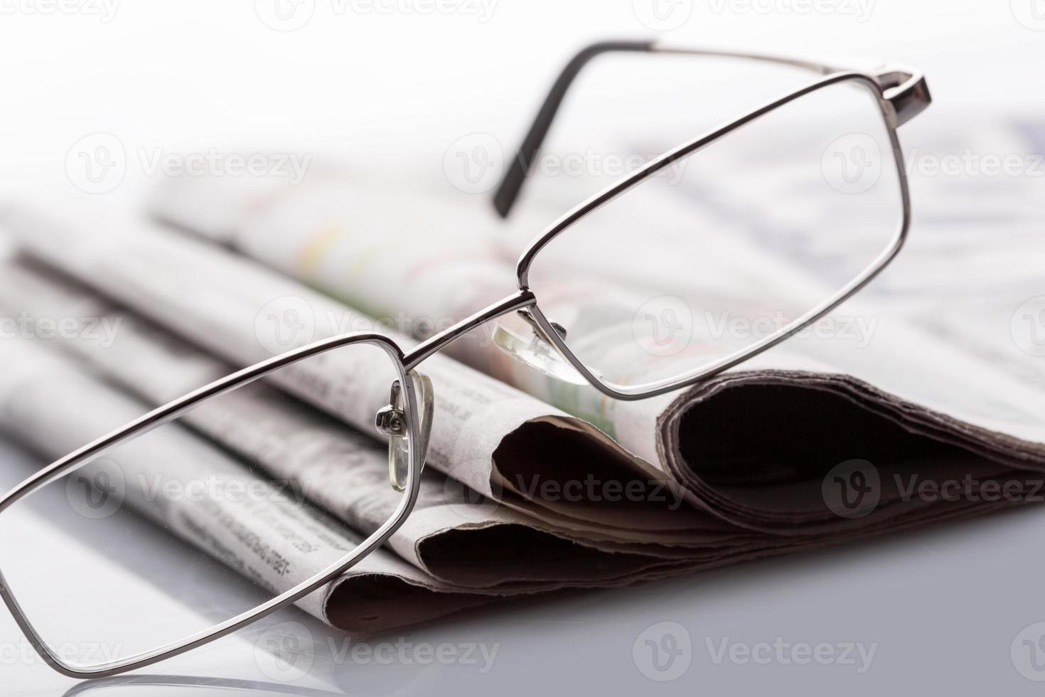 Glasses on the newspapers photo