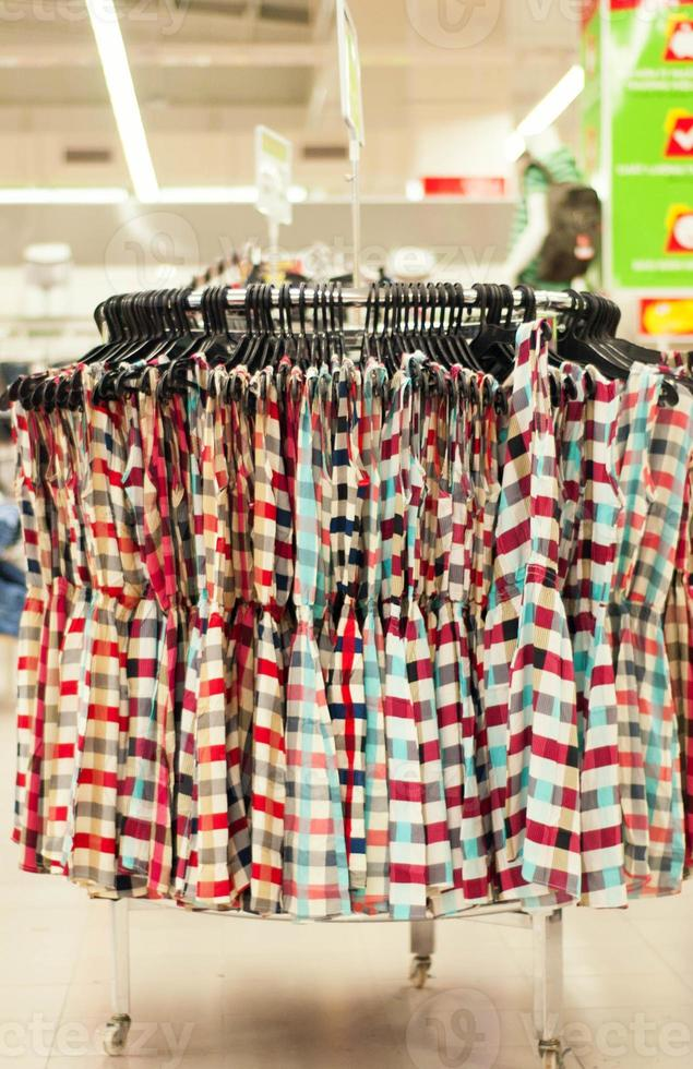 Clothes sale in a supermarket photo