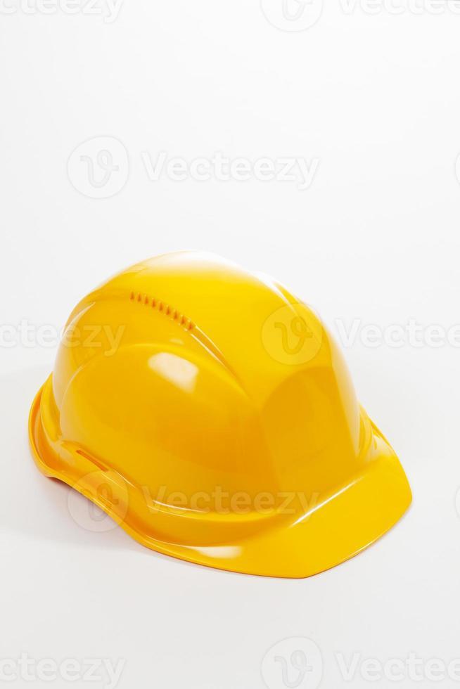 Yellow hardhat on white background photo