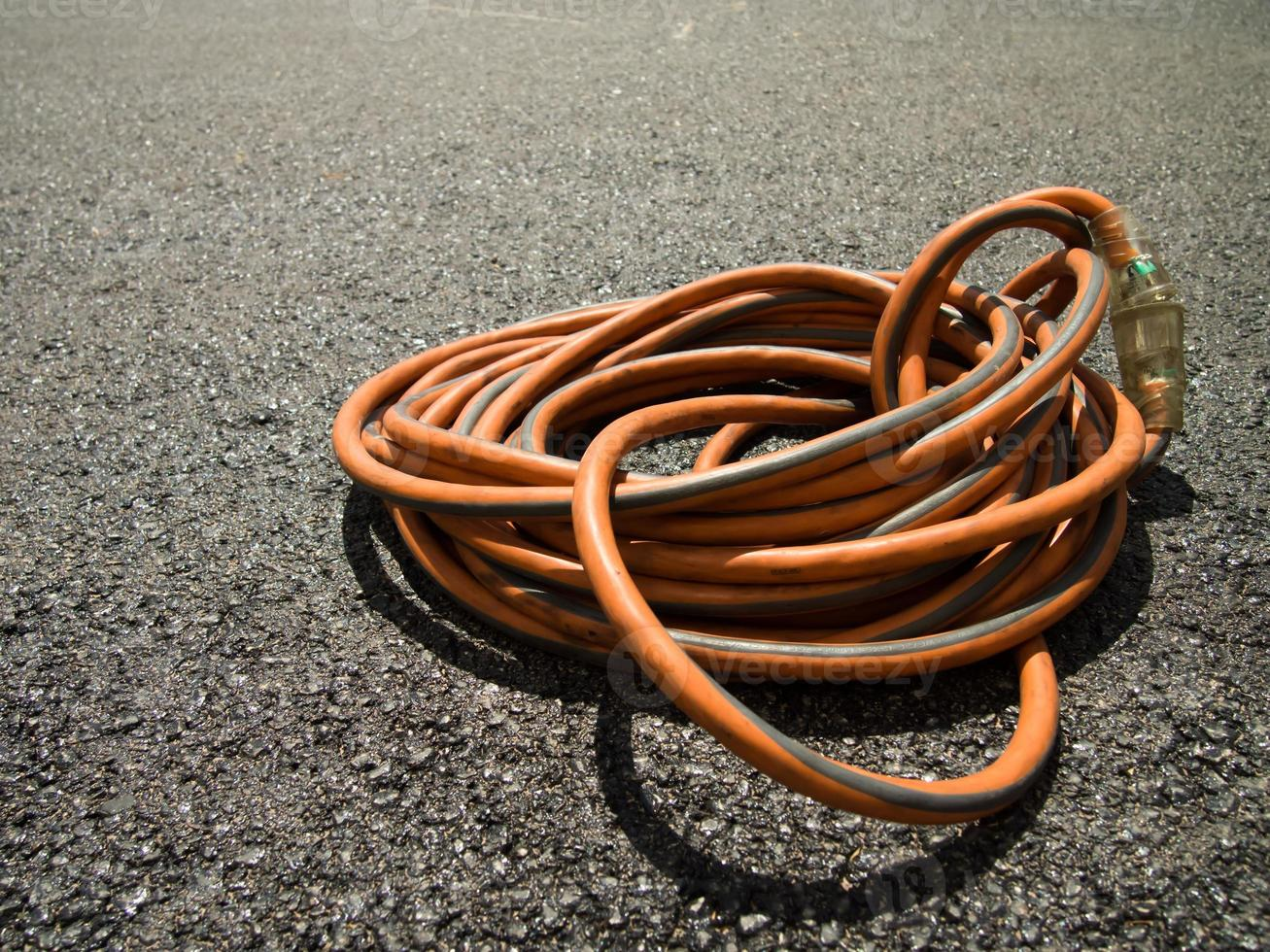 The Orange Extension Cord on the Ground at the Constructionsite photo