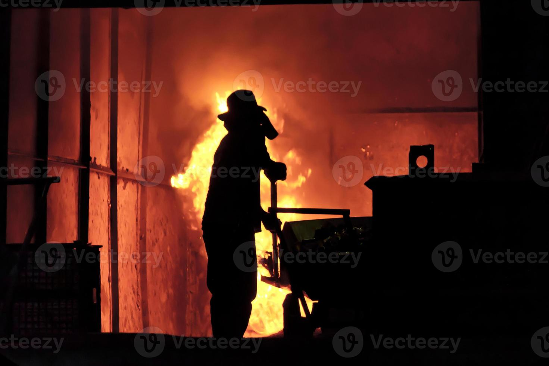 Man working in the splashing molten iron - Stock Image photo