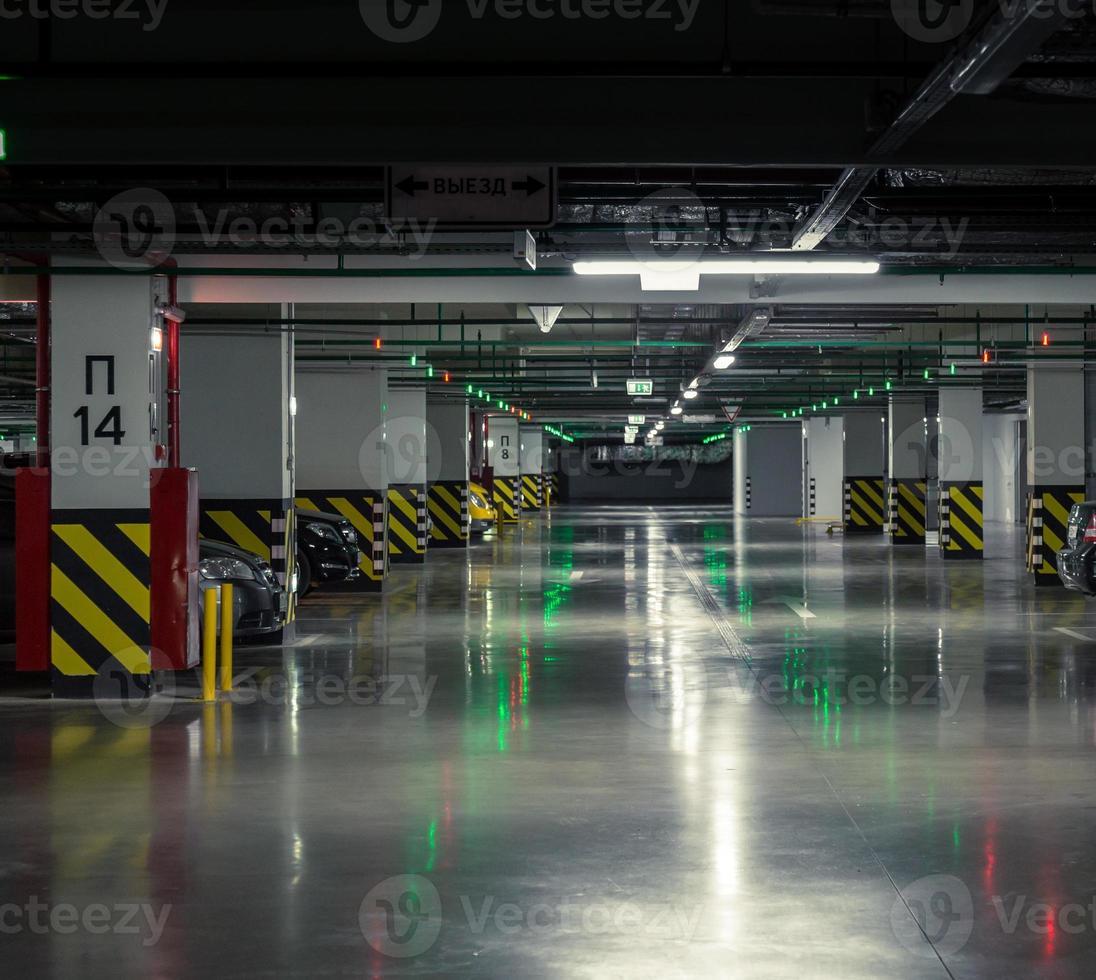 Parking garage, underground interior with a few parked cars photo