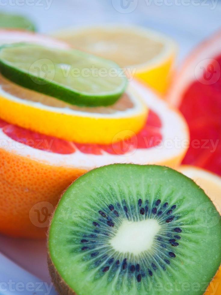 Colorful tropical fruits - lemon, kiwi, lime,  grapefruit photo