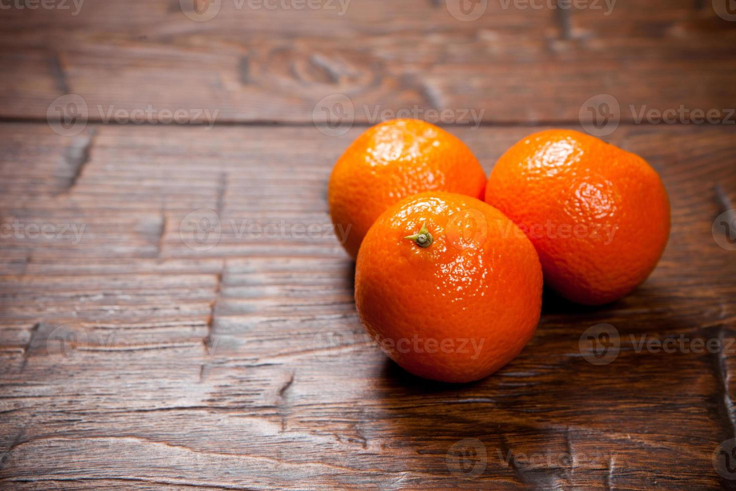 Tangerines on wooden table photo