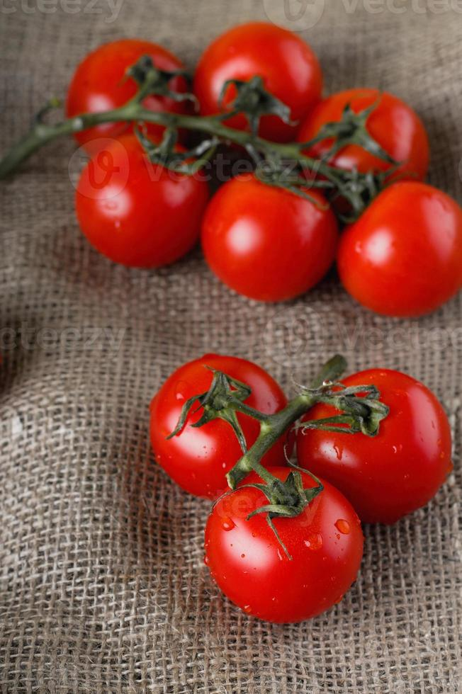 Red juicy tomatoes on jute cloth photo