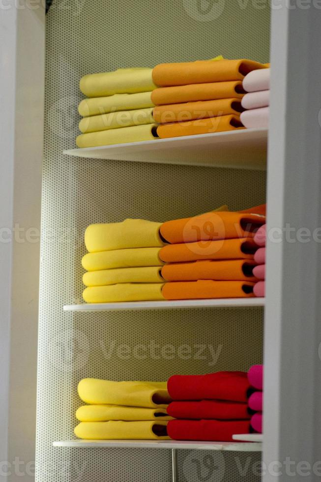 different colors polo shirt on display stand photo