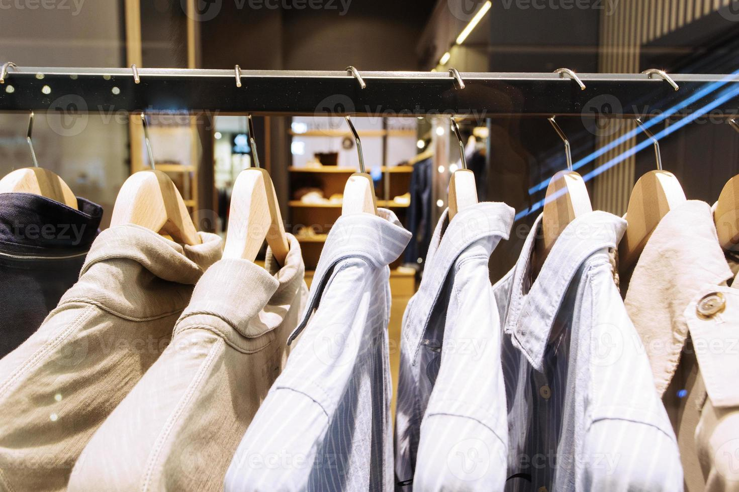 clothes on hanger in modern fashion shop photo
