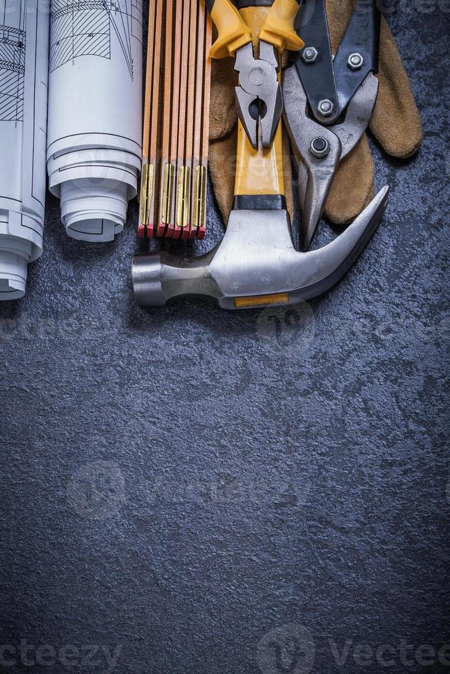 Blueprints wooden meter steel cutter pliers protective glove cla photo
