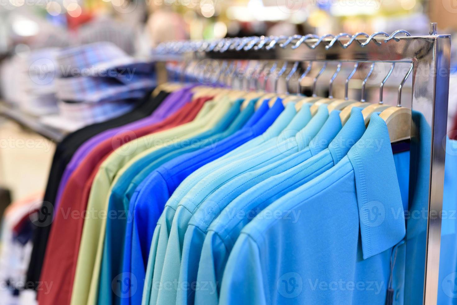 colorful clothes on Hangers photo
