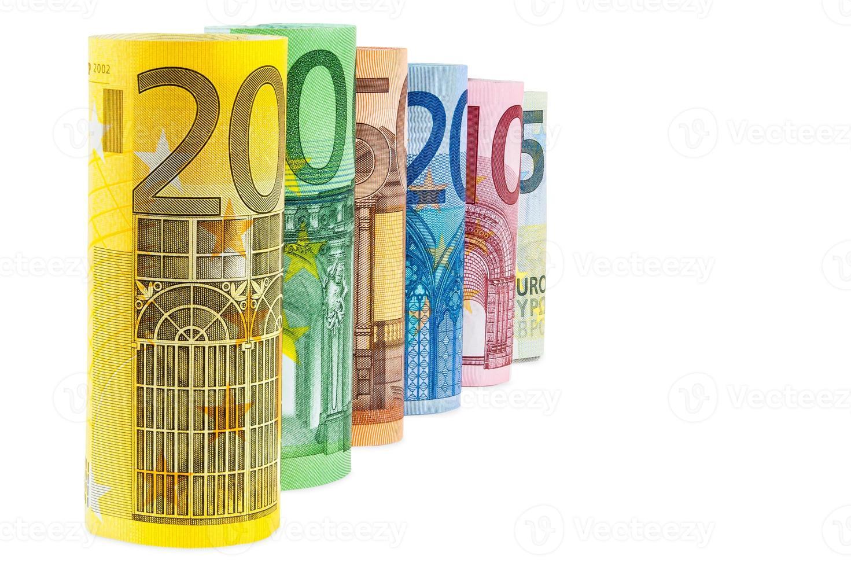 conjunto de billetes en euros enrollados foto