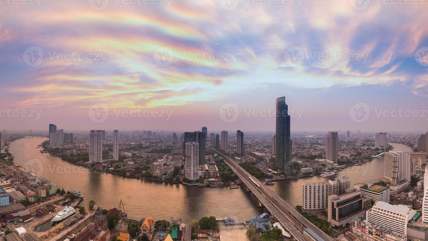 Panorama of Bangkok river curved aerial view skyline during twilight photo
