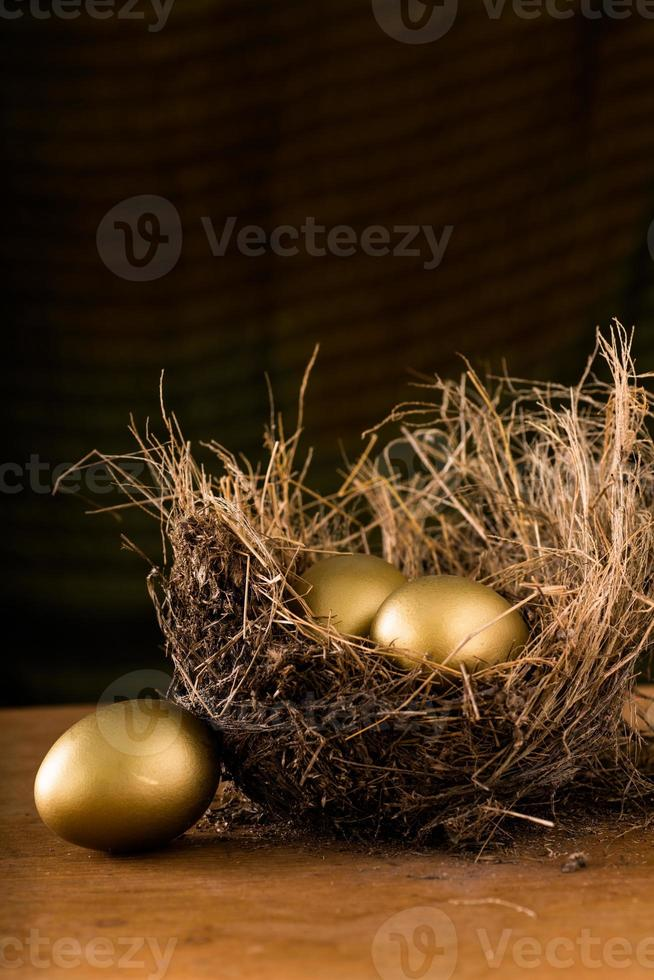 Hay Nest with 3 golden Eggs. photo
