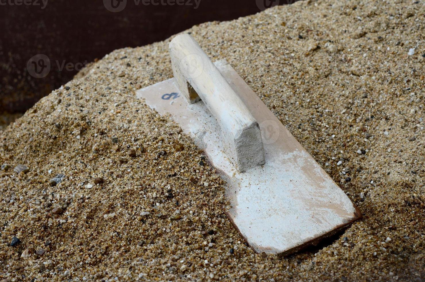 Plaster wood on sand photo