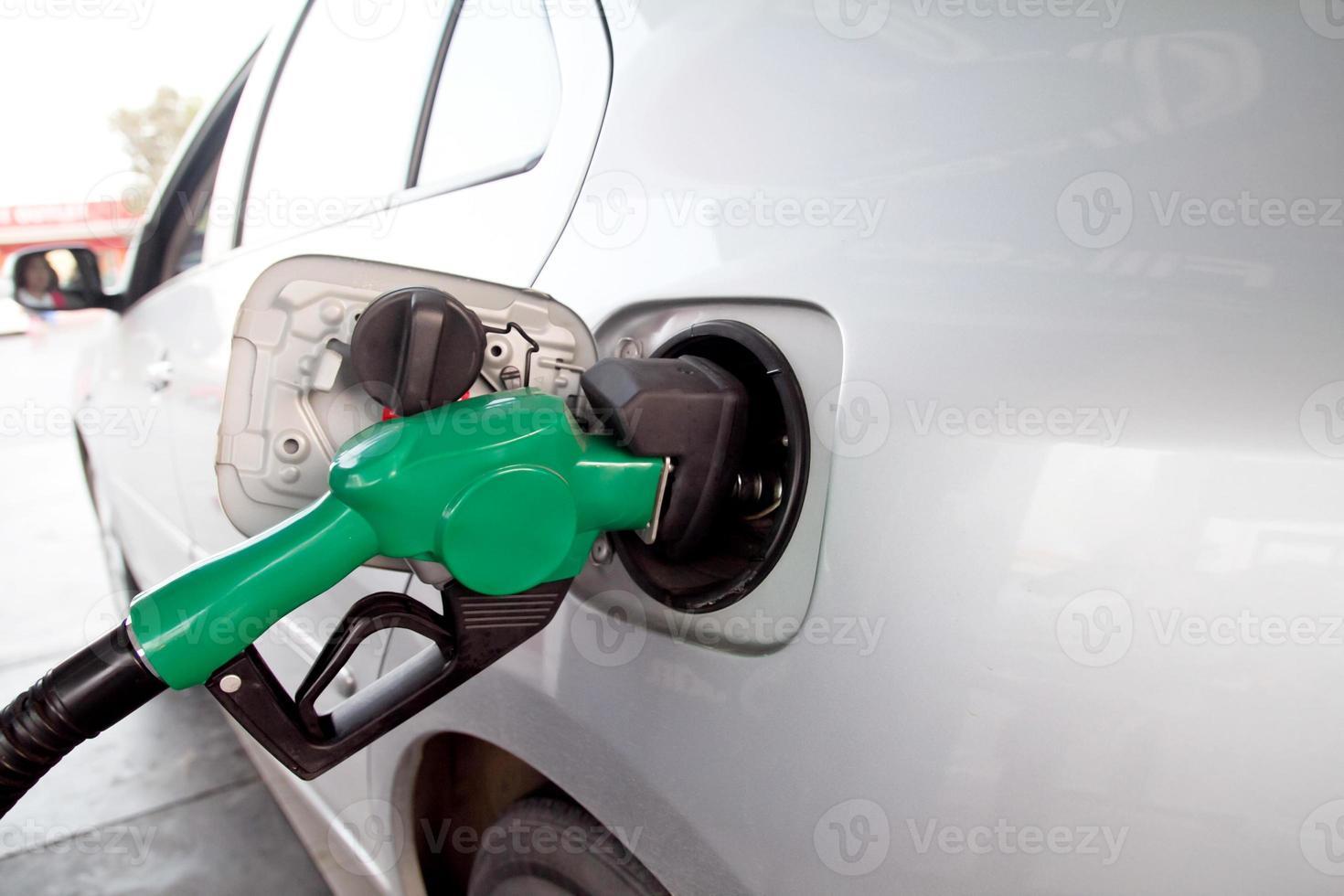 Pumping gas at gas pump. photo