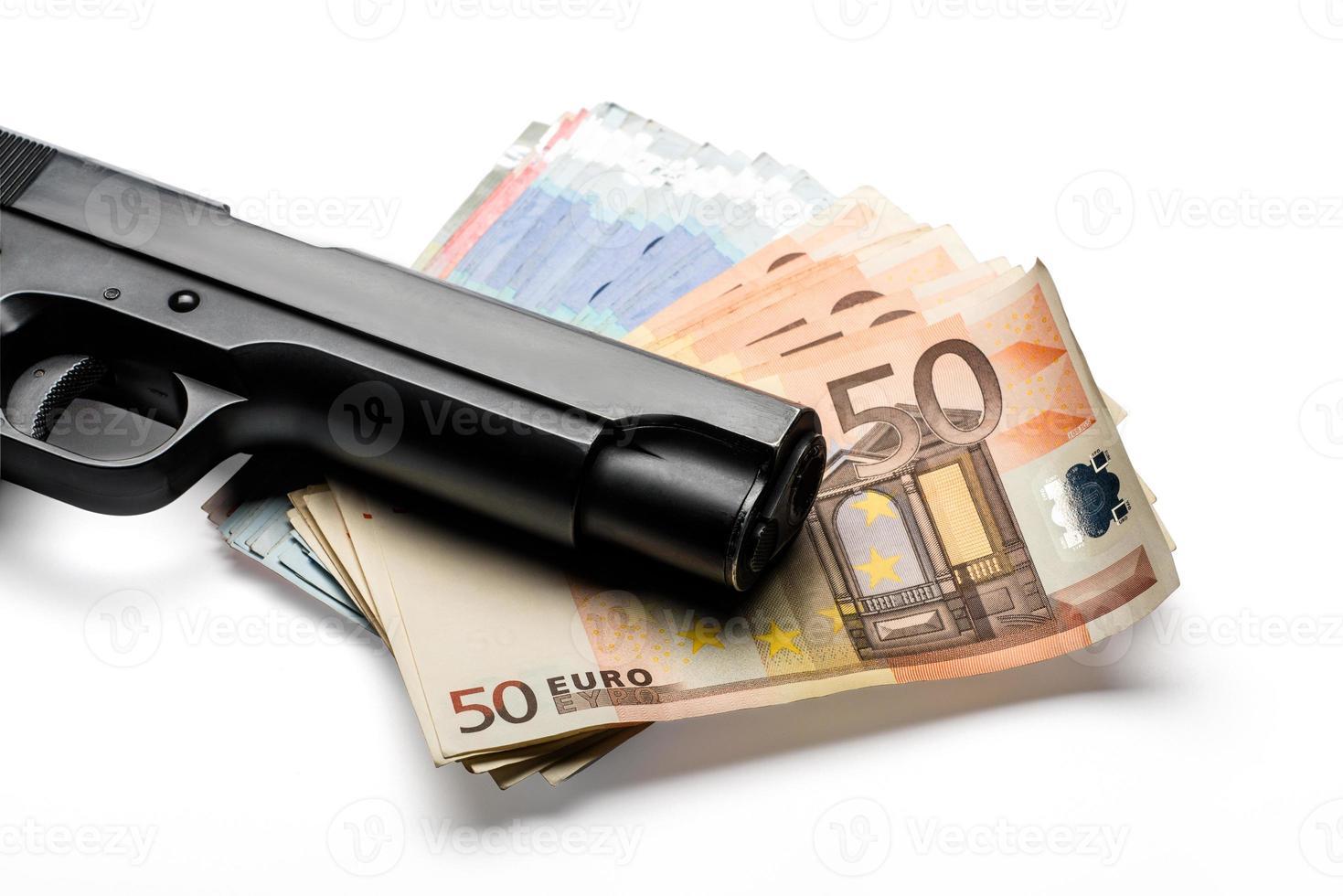 Bunch of euro banknotes with a gun photo