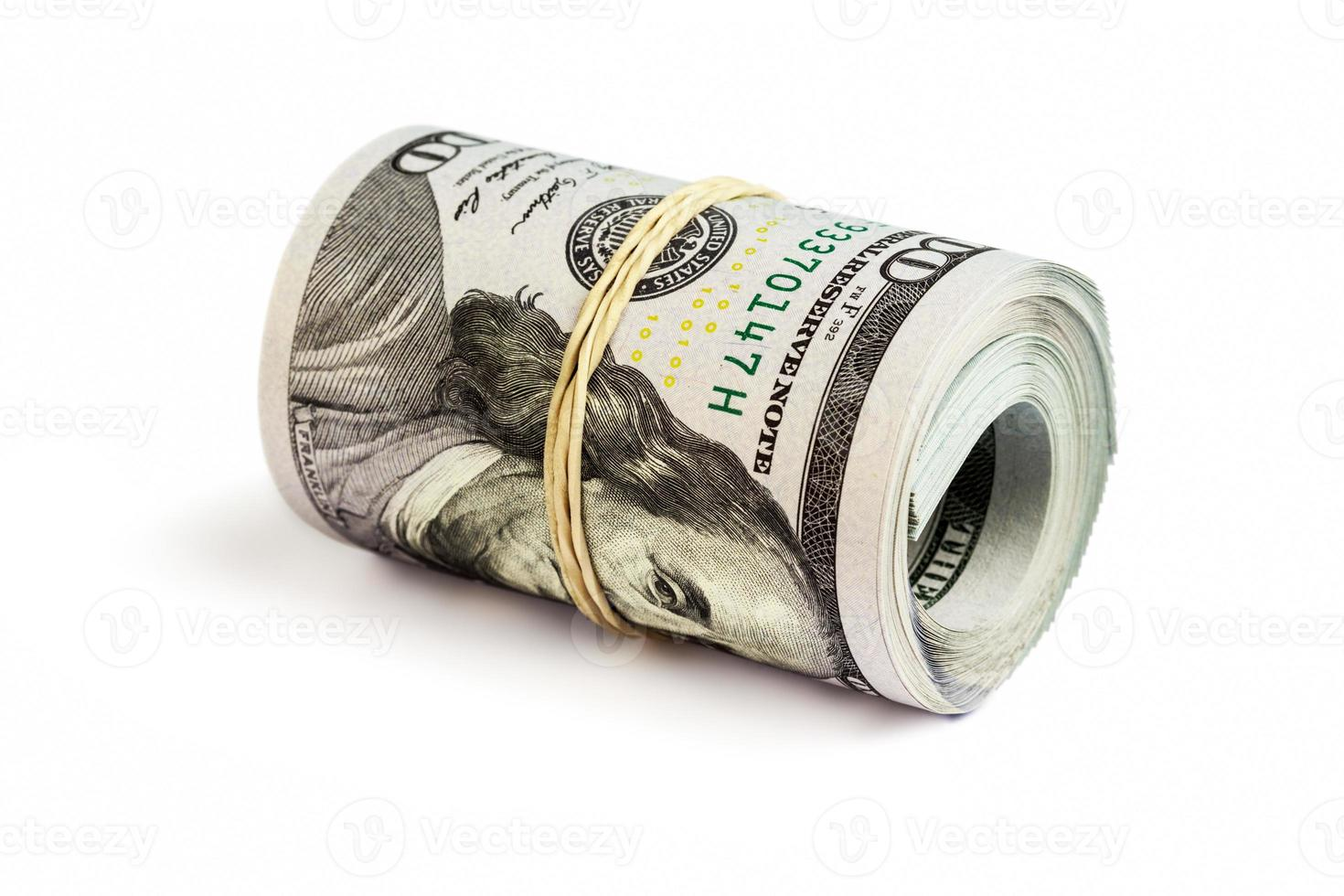 Roll of  hundred dollar bills isolated photo