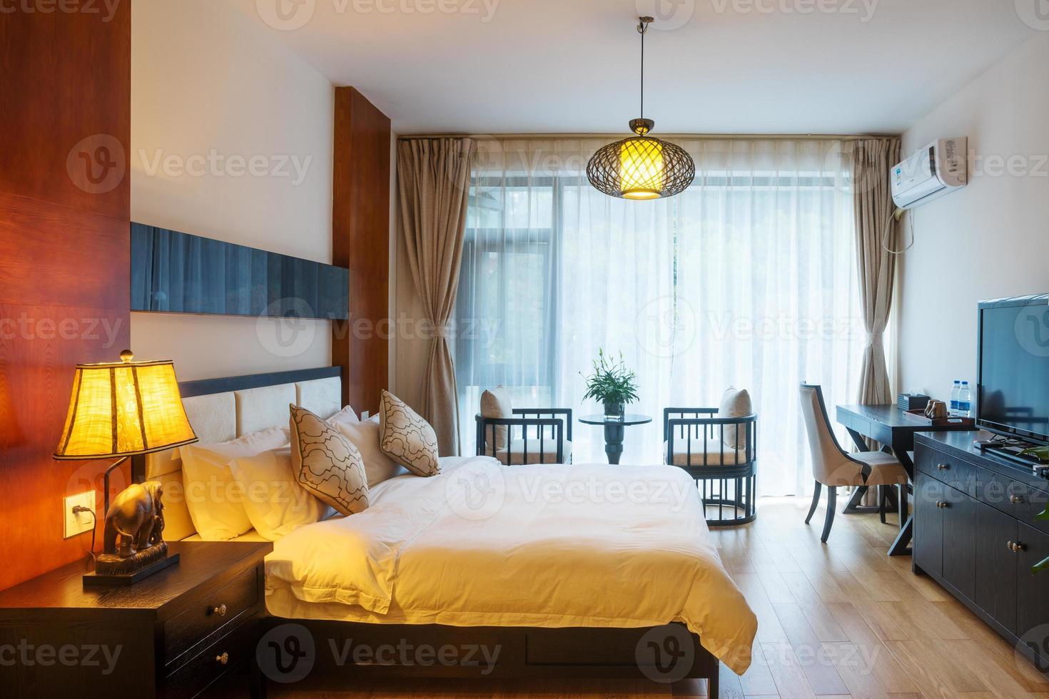 Night scene in hotel room: prepared fresh bed photo