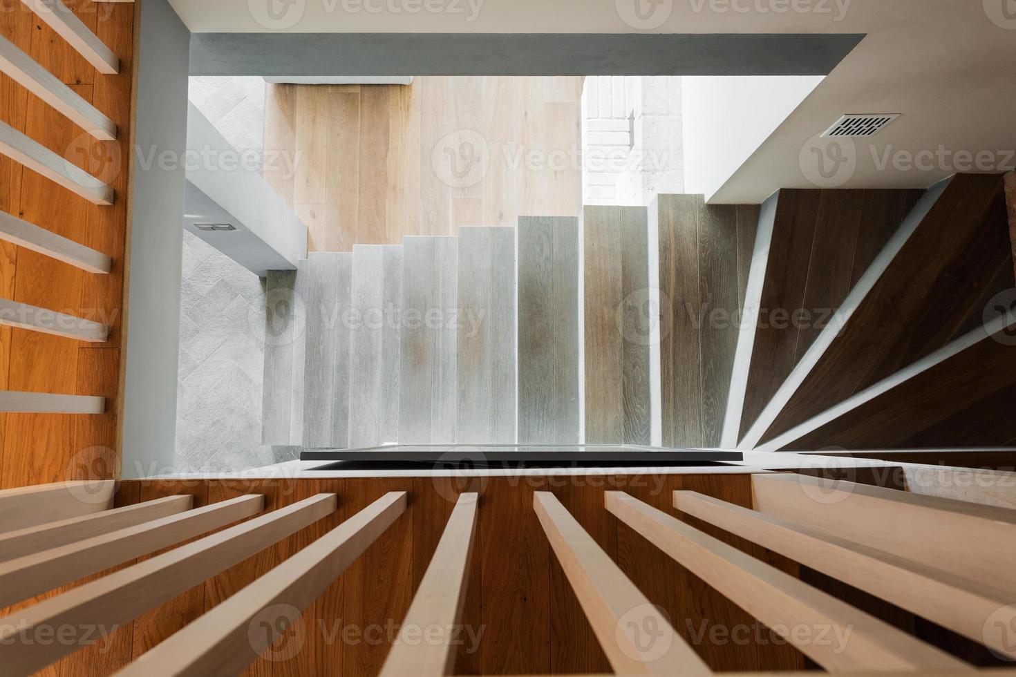 Spiral wooden stairs photo