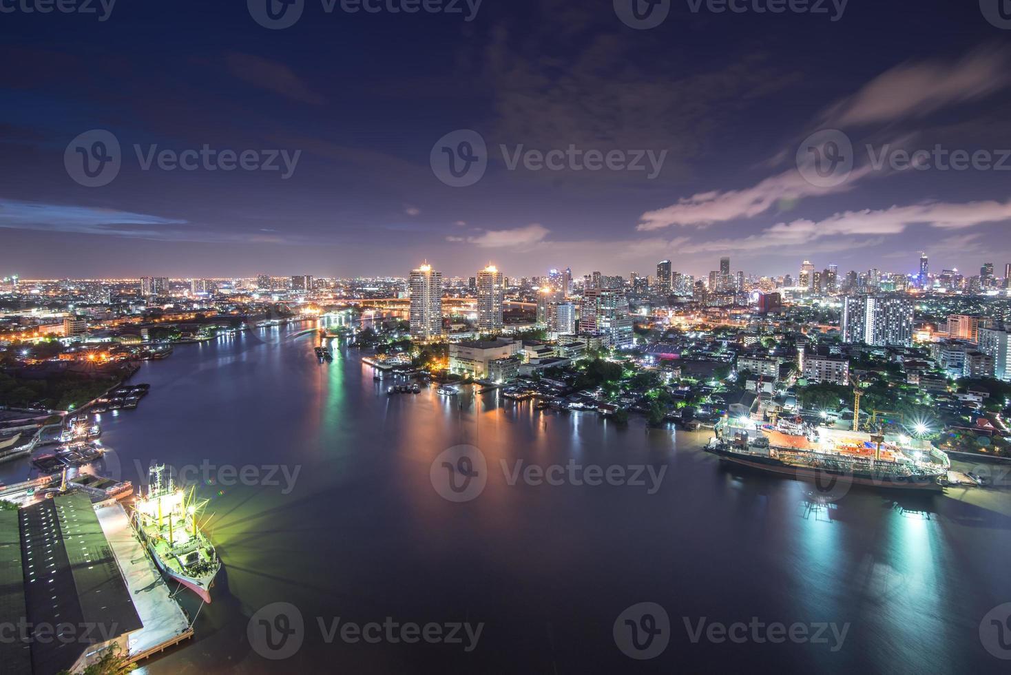 Bangkok Cityscape near river in twilight photo