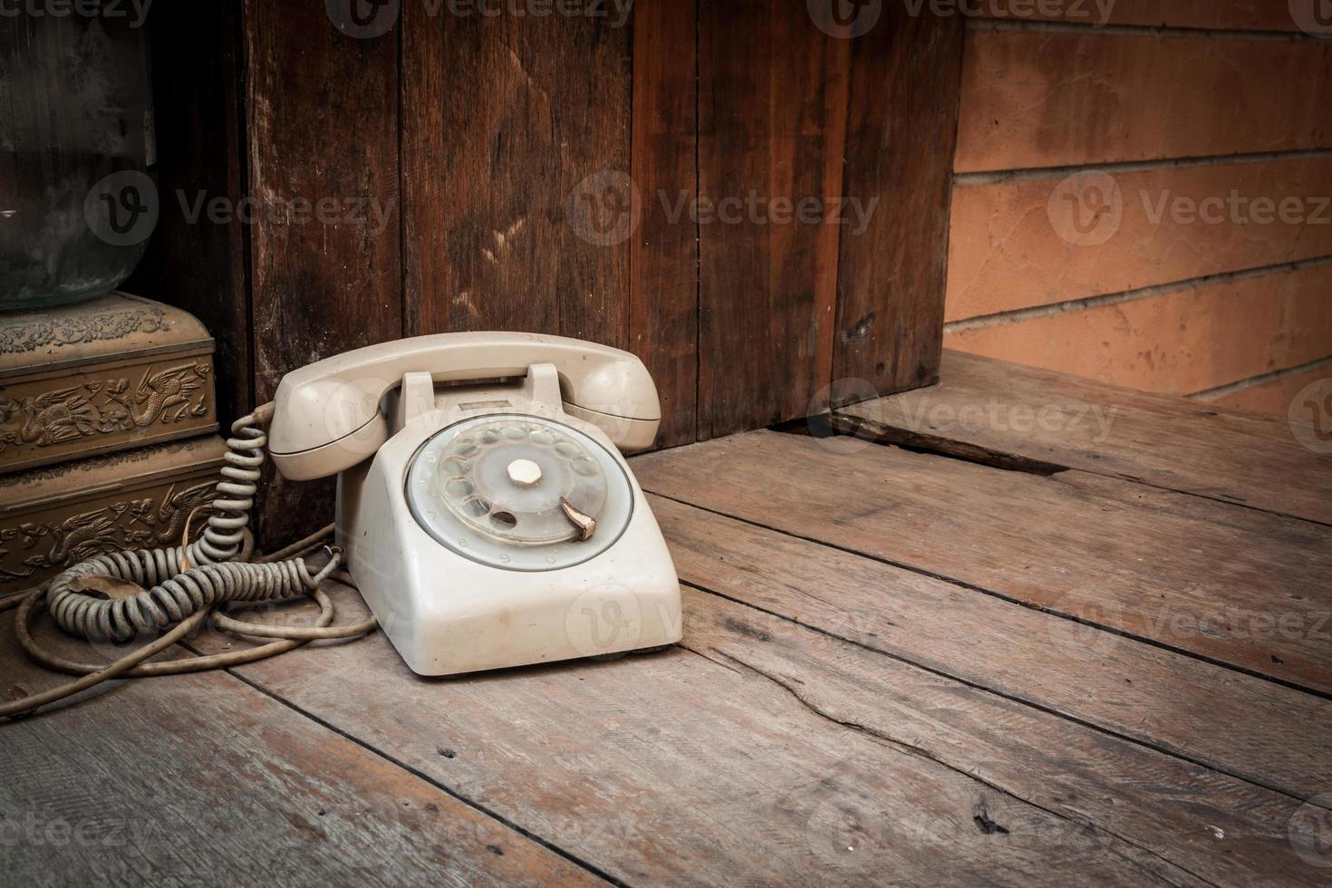 Vintage phone on wood background photo