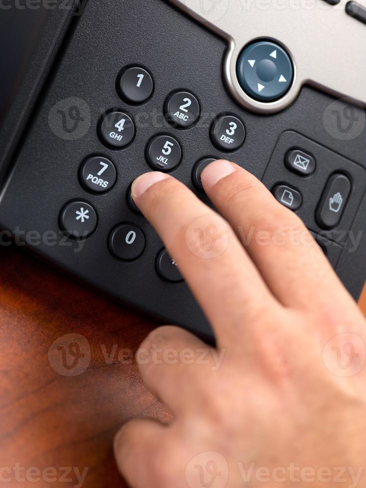número de marcación manual en el teléfono fijo negro foto