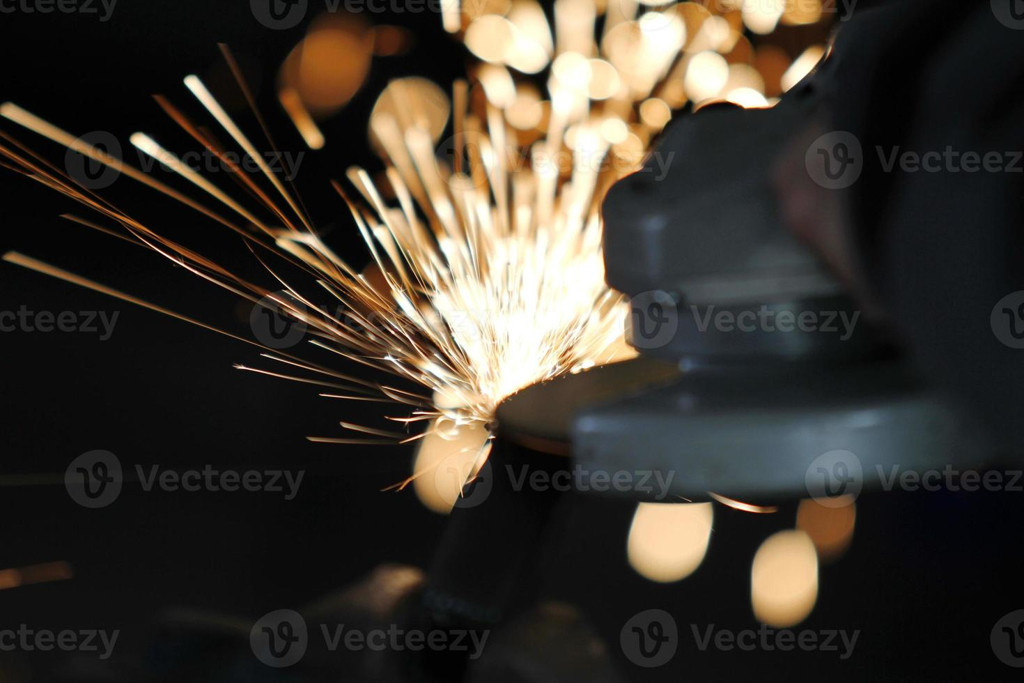 Electric wheel grinding on steel structure construction photo