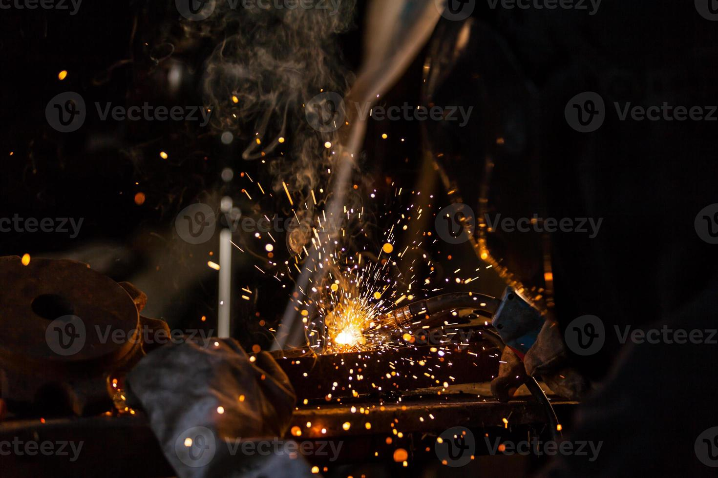 Welder in action. Low depth of focus photo