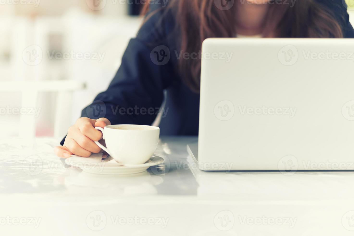 Asia woman in cafe with laptop and coffee, business concept photo